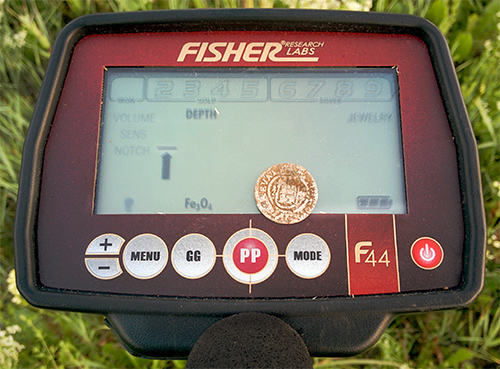 Fisher F44 metal detector and silver coin found