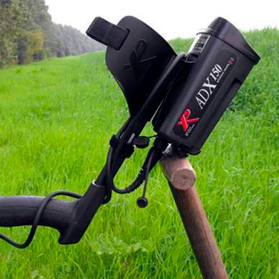 Metal detector XP GMAXX 150 on a green field with grass
